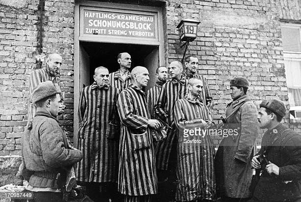 Soviet red army soldiers of the first ukrainian front with liberated prisoners of the auschwitz concentration camp in oswiecim, poland, 1945.