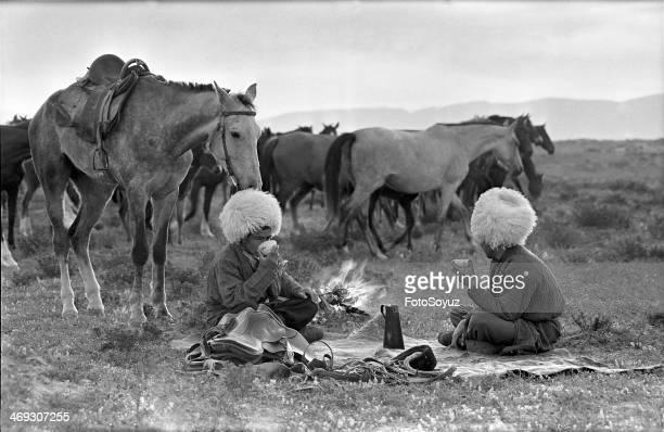Turkmenistan Horse breeding Pasturing of horses for the night Tea drinking