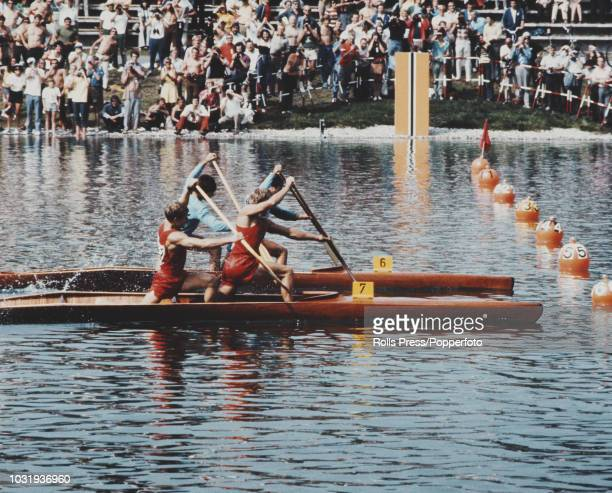 Soviet rowers Vladas Cesiunas and Yuri Lobanov of the Soviet Union team pictured in canoe as they battle against Ivan Patzaichin and Serghei Covaliov...