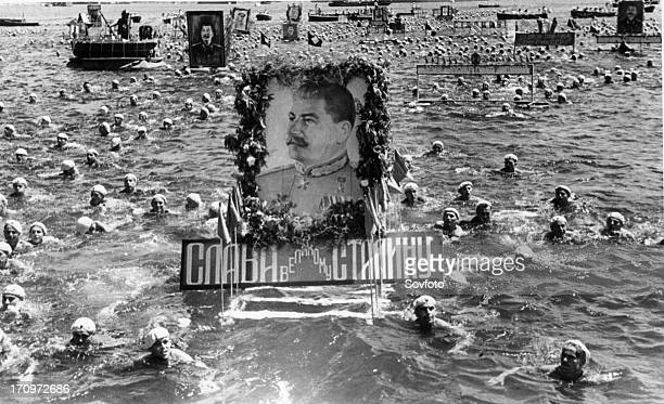 Soviet sailors swimming with floats with portraits of stalin in celebration of ussr navy day sevastopol ussr july 1950