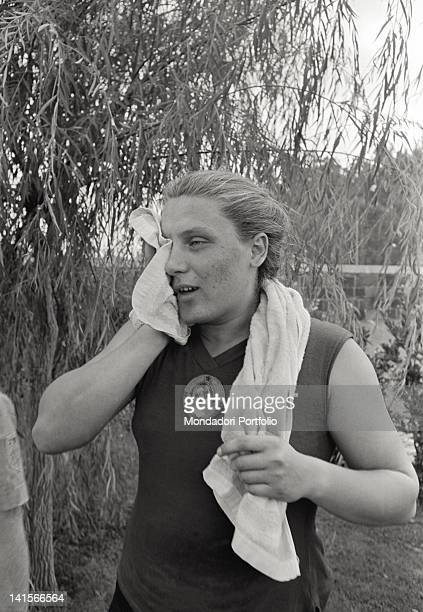 Soviet shot putter Tamara Press drying her face at the end of her training during the Rome Olympic Games Rome 1960