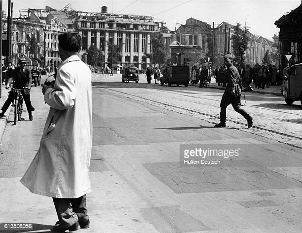 A Soviet soldier retreats to the Sovietcontrolled area of Berlin after chasing a group of British and German photographers The photographers were...