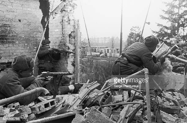 Soviet soldiers firing from destroyed building Russian Front WWII