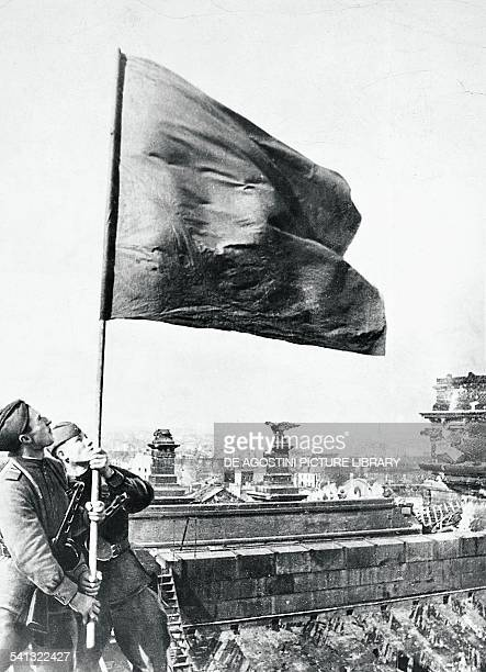Soviet soldiers hoisting the red flag over the Reichstag in Berlin May 1945 Second World War Germany 20th century