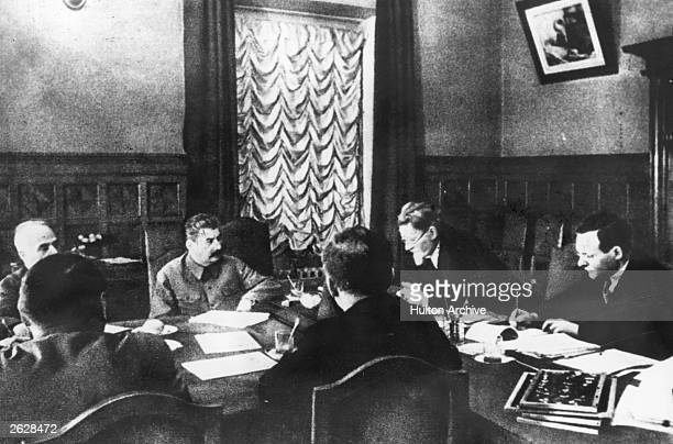 Soviet statesman and marshal Joseph Stalin in a session of the Praesidium of the Supreme Council of the USSR Original Publication People Disc HW0290