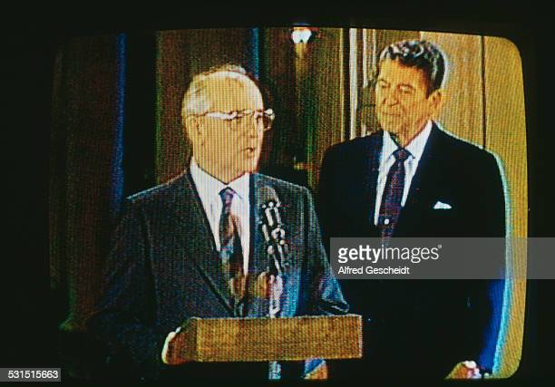 Soviet statesman Mikhail Gorbachev and US President Ronald Reagan on television USA 8th December 1987 They are both present to sign the...