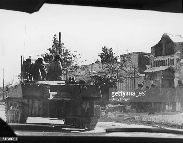 Soviet tank rolls through the countryside during Afghan Civil War Afghanistan