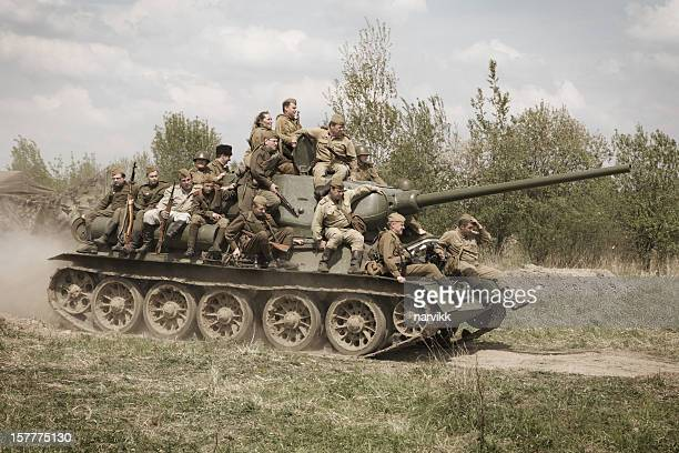 soviet tank t-34 with group of red army soldiers - armored tank stock photos and pictures