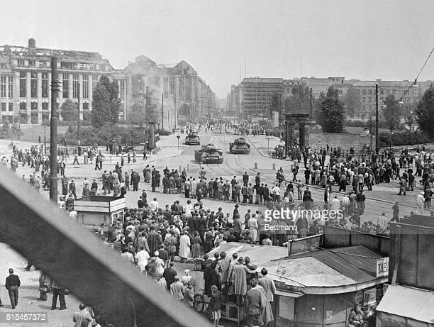 Soviet tanks and machine guns round a turn into Potsdamer Platz to push back crowds of demonstrating workers in East Berlin in the open rebellion...