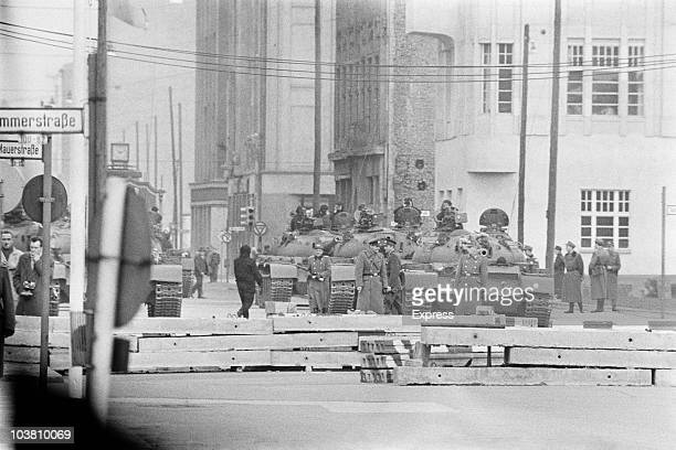 Soviet tanks and troops at Checkpoint Charlie a crossing point in the Berlin Wall between the American and Soviet sectors of the city at the junction...
