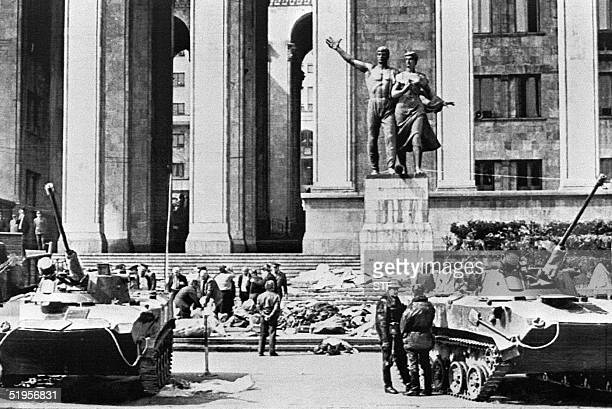 Soviet tanks are positioned in front of the Georgian government building 08 April 1989 where 18 pro-independence Georgians were killed after...