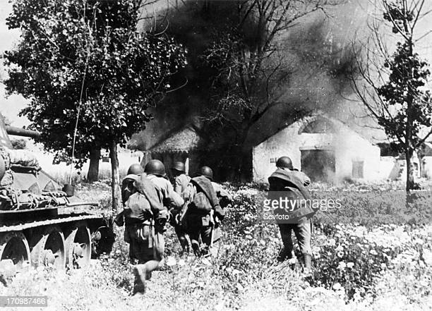 Soviet tanks carrying a party of tommygunners into a strongpoint of the hitlerites at ukrainian front lvov direction