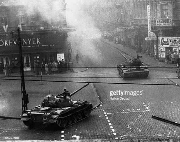 Soviet tanks cross a Budapest street as they move in to crush the anticommunist revolt