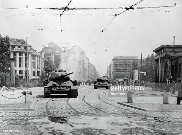 Soviet tanks rumble through East Berlin streetsSoviet tanks are shown as they rumbled through East Berlin streets this Wednesday after crushing an...