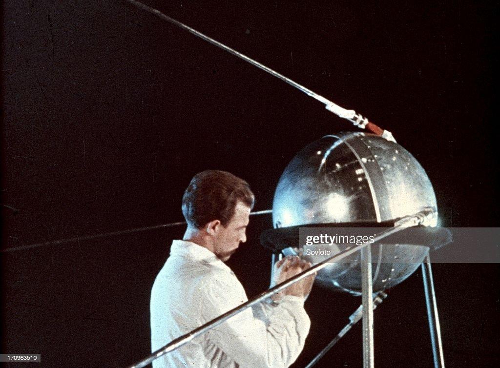 Soviet technician working on sputnik 1, 1957.