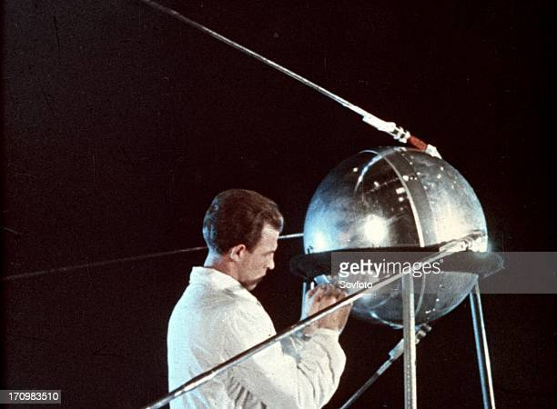 Soviet technician working on sputnik 1 1957