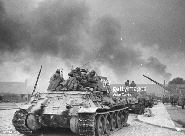 Soviet troops aboard a T-34 tank. Dubbed, 'The Attached Infantry', their batallions endeavoured to protect tanks from anti-tank weaponry. The...