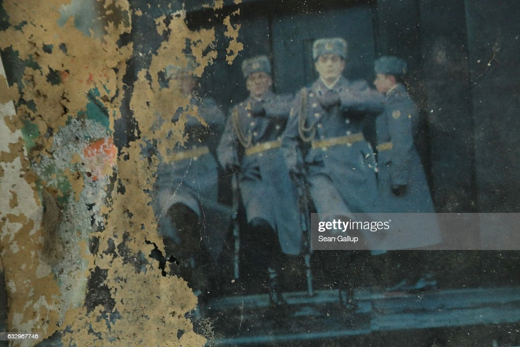 Soviet troops are visible on an ageing Russian calendar on a wall in the officers' building at the former Soviet military base on January 26, 2017 in Wuensdorf, Germany. Wuensdorf, once called 'The Forbidden City,' was the biggest base for the Soviet armed forces in communist East Germany from 1945 until the last Soviet troops left in the early 1990s following the end of the Cold War and the reunification of Germany. While Soviet troops pulled out of eastern Europe after 1989, Russian troops have in recent years intervened in Ukraine. The NATO military alliance has strengthened its presence in the Baltic states in an effort to prevent similar Russian intervention there.