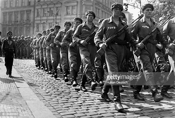 Soviet troops march through Prague in September 1968 after invading the city to stop the momentum of the democratic reforms instituted during the...