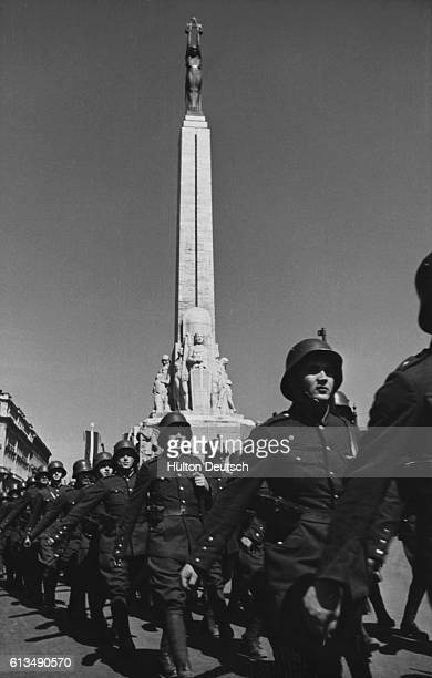 Soviet troops parade near the Freedom Monument during World War II.