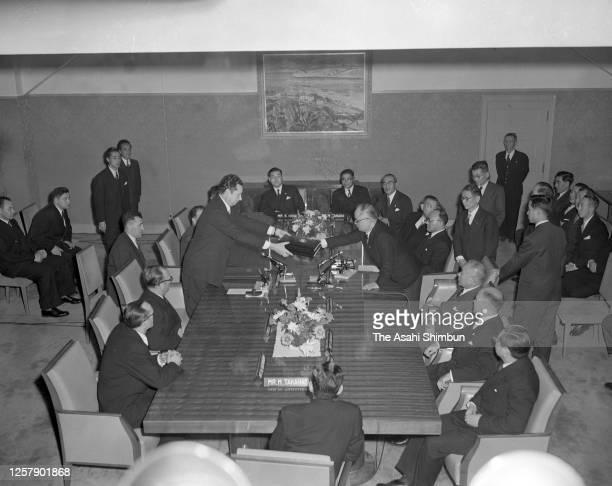 Soviet Union Deputy Foreign Minister Nikolai Fedorenko and Japanese Foreign Minister Mamoru Shigemitsu exchange the documents as the Soviet-Japanese...