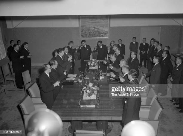 Soviet Union Deputy Foreign Minister Nikolai Fedorenko and Japanese Foreign Minister Mamoru Shigemitsu toast glasses after exchanging the docments as...
