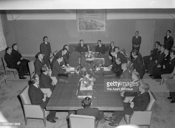 Soviet Union Deputy Foreign Minister Nikolai Fedorenko and Japanese Foreign Minister Mamoru Shigemitsu sign the documents as the Soviet-Japanese...