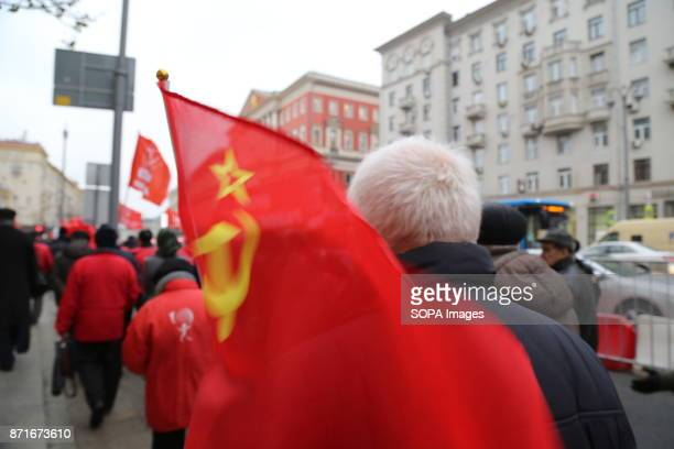 A soviet union flag is being carried by a participant of the march Thousands marched to Revolution Square in central Moscow to commemorate the 100th...