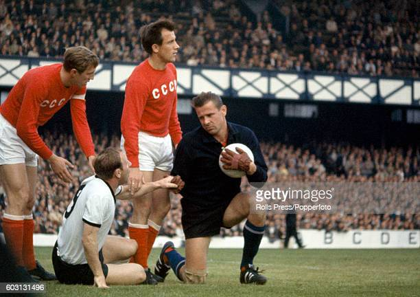 Soviet Union goalkeeper Lev Yashin helps West Germany striker Uwe Seeler to his feet watched by Albert Shesterniev and Vasili Danilov after a...