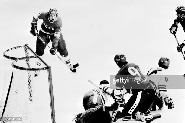 Soviet Union hockey player Alexander Yakushev scores a third goal in the final game against the Czechoslovakia hockey team on February 14 1976 during...