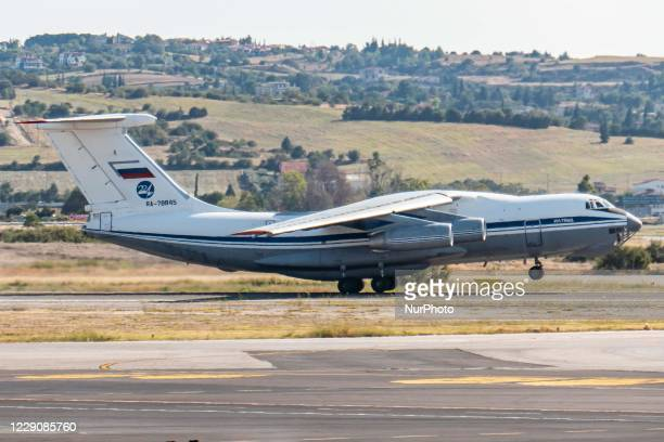 Soviet Union made Ilyushin Il-76MD commercial freighter aircraft carrying heavy cargo as seen parked on the tarmac and taking off from Thessaloniki...