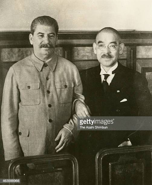 Soviet Union Premier Joseph Stalin and Japanese Foreign Minister Yosuke Matsuoka pose for photographs after the signing of the SovietJapanese...