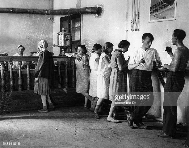 Soviet Union Russian SFSR Moscow Students drinking tea in the canteen of Moscow University around 1925 Photographer James E Abbe Vintage property of...