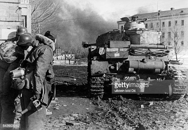Soviet Union Ukrainian SSR Charkov Kharkov Kharkiv 2 World War Eastern Front tank and soldiers in the city during the German invasion 1943...