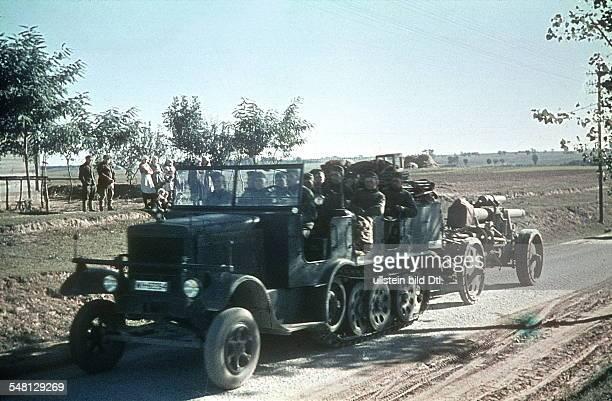 Soviet Union Ukrainian SSR World War II German artillery on the advance in the Ukraine halftrack pulling a field gun summer 1941 Photographer Artur...