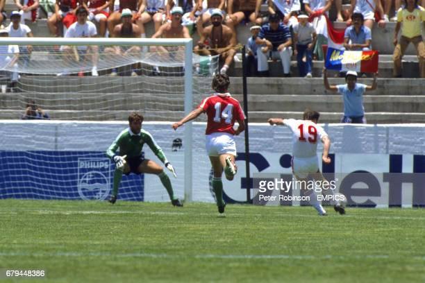 Soviet Union's Ihor Belanov shoots towards Hungary goalkeeper Peter Disztl