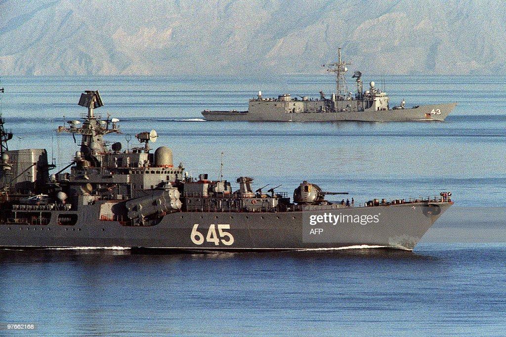 A Soviet warship (foreground) passes alo : News Photo