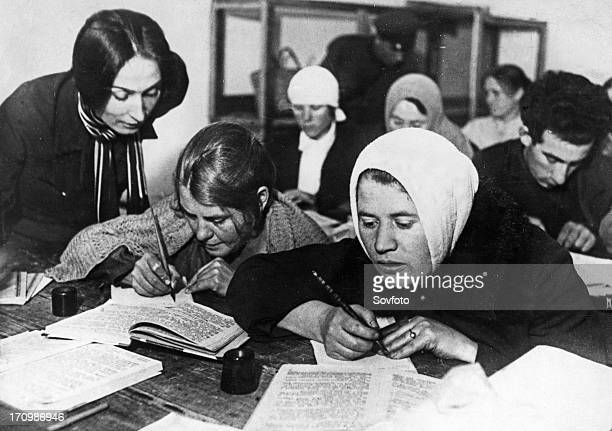 Soviet women being taught to read and write during a literacy drive in the early 1930s ussr