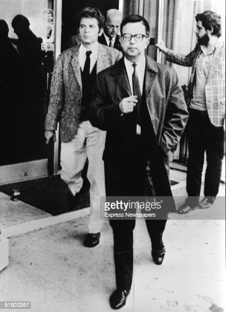 Soviet world chess champion Boris Spassky wears a jacket as he walks out of the Reykjavik Exhibition Hall after he decided not to play tempermental...