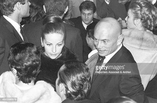 Sovietborn American actor Yul Brynner and his wife Doris Kleiner attending a Sammy Davis Jr's recital Paris 1963
