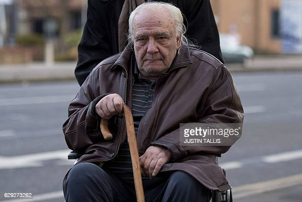 Sovietera dissident Vladimir Bukovsky is pushed in a wheelchair as he arrives at Cambridge Crown Court in Cambridge east England on December 12 2016...
