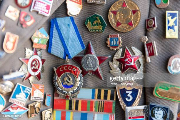 soviet-era medals and jacket pins - global awards stock pictures, royalty-free photos & images