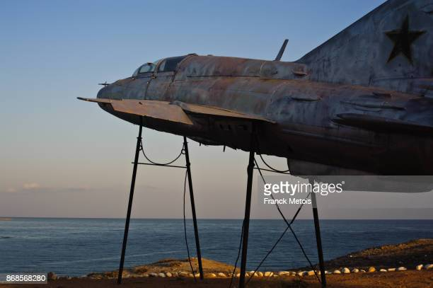 soviet-era plane on a plinth above lake issyk-köl ( kyrgyzstan) - former soviet union stock pictures, royalty-free photos & images