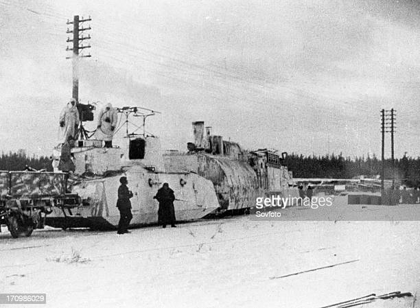 Sovietfinnish war 19391940 a finnish armored train captured by the red army the near car has light field guns machinguns and wireless the far car is...
