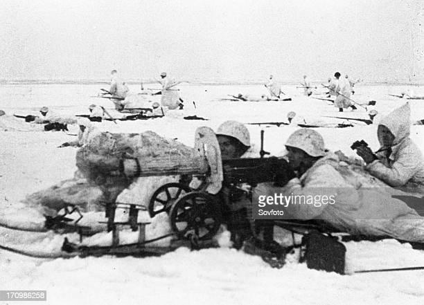 Soviet-finnish war, 1939-1940, a soviet machine-gun crew, using maxim machine-guns, supporting advancing infantry, a still from the newsreel...