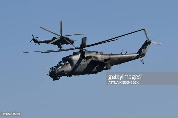 Soviet-made Mi-24 helicopters of the Hungarian army maneuver in the sky over a military training center nearby Ujdoeroegd, Hungary, on March 5, 2020...
