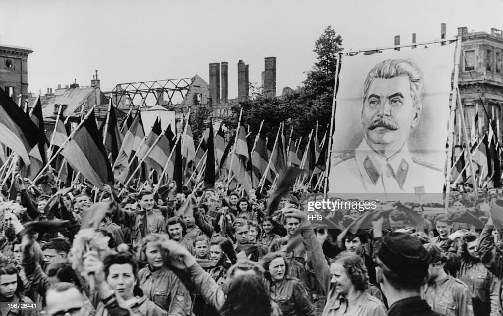 A Soviet-sponsored youth rally in the Lustgarten in Berlin, Germany, 1st June 1950. The youth carry huge portraits of Communist leaders such as Joseph Stalin (pictured).