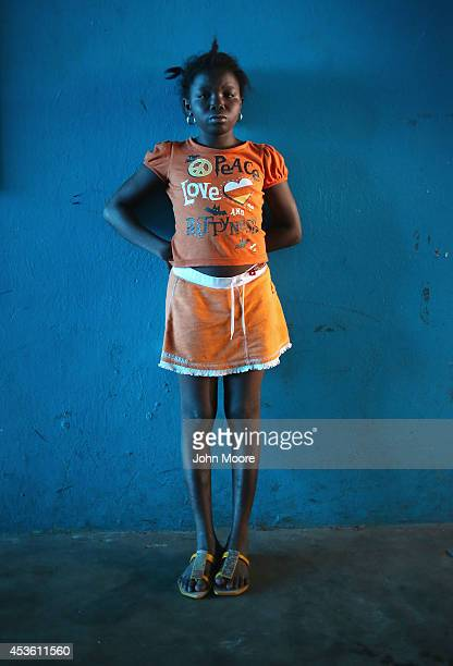 Sowe who's mother says she is 15 stands in a newlyopened Ebola isolation center set up in a school closed due to the epidemic on August 14 2014 in...