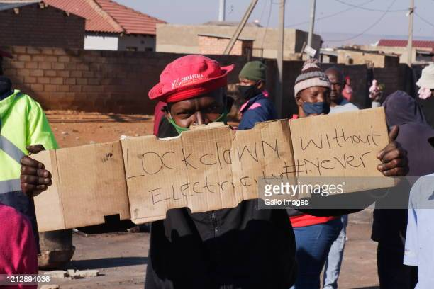 Soweto residents protest over lack of electricity during lockdown level 4 in Snake Park on May 13, 2020 in Soweto, South Africa. It is reported that...