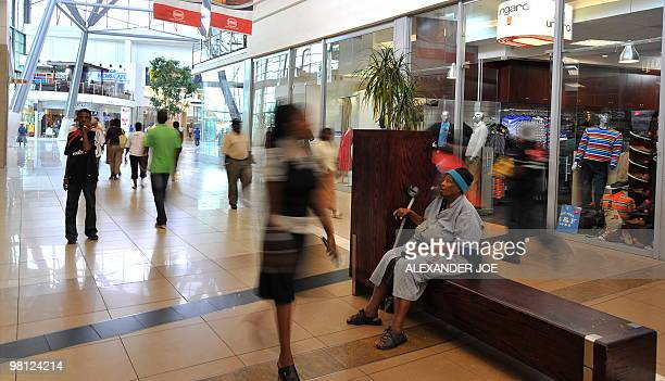 Soweto residents shop at Maponya Mall in Soweto on March 19 2010 This is the new Soweto a mix of uppercrust comforts and urban grit where shopping...
